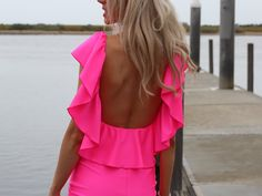 ~Hot fitted neon pink mini ruffle dress ~Low back with cascading ruffles around the front & back ~Super bright and shiny light lycra fabric (4 way