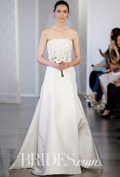 Brides.com: . Ivory silk faille wedding dress with embroidered organza and chiffon bodice, Oscar de la Renta