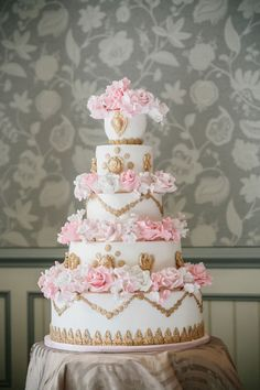 Stunning!! ~ Marie Antoinette wedding cake~    white and gold cake with pink sugar flowers.