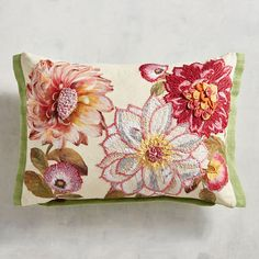 Decorated with embroidered and appliqued flowers, then set off with striped flanged ends, our oblong pillow will add color and sweet comfort to your sofa, chair or bed.