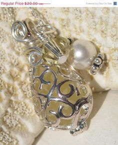 Sea Glass Necklace Pendant- Mermaids Teardrop Locket - Rare Yellow. $20.00, via Etsy.