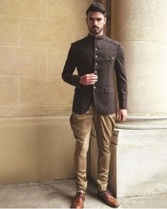 Design 7930 Men's black suede Jodhpuri with gold jodhpurs. Shoes not included. Availability may vary, depending on the size. weeks time frame for all Custom order completion. Mens Wedding Wear Indian, Mens Indian Wear, Mens Ethnic Wear, Wedding Dresses Men Indian, Indian Groom Wear, Wedding Dress Men, Indian Men Fashion, Mens Fashion Suits, Wedding Suits