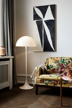 VERNOR PANTON - LOUIS POULSEN PANTHELLA FLOOR LAMP The king of weird silhouettes, Verner Panton, designed the Panthella floor lamp in 1971. It comes in a range of sizes and colors, but the classic opal floor lamp is an icon of Danish design. It manages to be both playful and minimalist at the same time, and provides a glowing light that is suited to a wide swath of spaces.