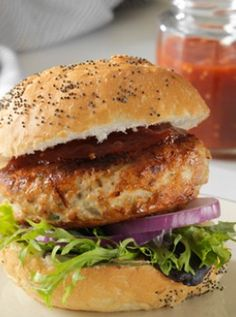 CHIA CHICKEN BURGERS ON FOCCACIA BUNS ½ kilo ground (minced) chicken  ½ cup cooked brown rice or quinoa  ½ cup grated carrot  ½ cup grated zucchini  2 tbsp finely chopped parsley  2 – 3 tsp black Chia seeds  1 tsp sea salt, pepper (or to taste) Olive or coconut oil (for cooking)  4 foccacia bread buns  Mayo, ketchup or tomato chutney  Tomatoes, greens and red onions  Cheese (optional)