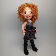 It's your beloved River Song, secret daughter of Amy and Rory, lover of the Eleventh Doctor. Create her and her wild curls using this easy pattern.