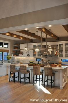 white kitchen w/rustic beams | gray & marble counters