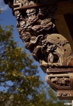 Outdoor wood carving details on a traditional Chinese building