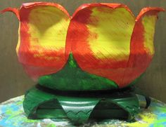 Red on Yellow Recycled Tire Flower Planter/Party Cooler on Wood
