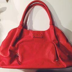 """Authentic Kate Spade purse with dust bag Leather Kate Spade purse that is red orange in color.  Dimensions: 15"""" w x  8"""" h x 6"""" d with 7.5"""" between purse and handle.  Like new with one small mark on front.  See photo 4. kate spade Bags Shoulder Bags"""