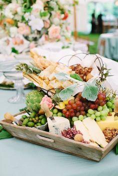 bread, cheese, fruit, etc.... display....
