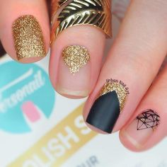 Glam gold and black nail design