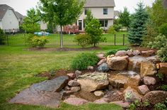 Before and After Photos Diy Pondless Waterfall, Garden Waterfall, Waterfall Building, Low Maintenance Backyard, Waterfall Features, Water Features In The Garden, Backyard Landscaping, Outdoor Lighting, Landscape Design