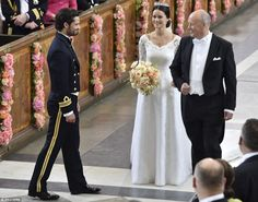 Beautiful: Prince Carl reportedly cried when he saw his wife walking down the aisle, which was decorated with pastel-coloured flowers