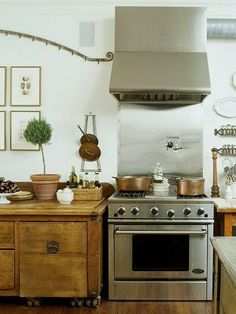 Wood cabinets in kitchen with copper & brass
