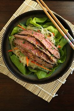 Adding steak to a heaping pile of greens and noodles is a delicious way to use up leftover beef. Follow this recipe and toss the noodles in the dressing the night before. That way, it's easy packing the next morning.  Photo: Anna Monette Roberts