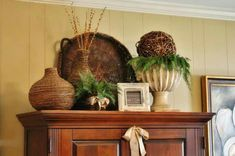 I like this look on top of a cabinet or armoire