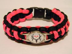 550 Paracord Bracelet Cobra Weave Black And Neon Pink Bone Collector Charm. $12.99, via Etsy.