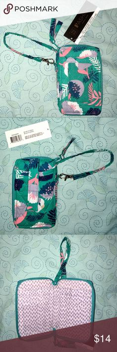 """NWT, Fabric Cell Phone Wallet Blue Floral Print. NWT, Fabric Cell Phone Wallet with Wrist Strap, Blue Floral Print.  Brand new with tags.  Wallet dimensions are approx 6.2"""" x 1.1"""" x 3.8""""  Inspired Design.  Info: •This fashion fabric wallet features a zipper closure with a wallet and interior slots for credit cards, drivers license and more.  •There are two exterior pockets with closures.  One is clear that would be great for your ID and another for holding a cell phone.  Wallet also has a…"""