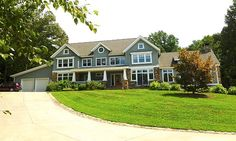 This New England-style home is in Winston-Salem. Beautiful and just love the front porch!