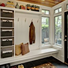 This could really be used for when children are going outside, they can use the bench to put on rain boots and use the hooks for rain coats or hats. I like how there are storage spaces too that could be used.