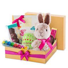 Order a vip gourmet gift basket of godiva easter chocolates for hop into spring with this festive golden godiva gift box filled with delightful easter treats for negle Choice Image