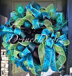 This is a custom listing for Sylvia Deluxe Peacock wreath with coordinating mailbow swag. $125 for the wreath $75 for the swag Shipping in