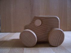 MUJI wooden van. The van's wheels are elliptical and the front and rear wheel pairs aren't aligned, which means it drives with a beautiful bounce. Simple genius.