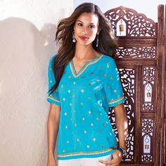"""Loose and flowy with just the right amount of shimmer, this gorgeous blue tunic with gold star and dot embroidery is a summertime essential. Features elbow length sleeves, a deep """"v"""" neckline and metallic trim at the neckline, sleeve hem and bottom hem. It is designed to fall at the hip. Regularly $19.99, buy Avon Fashion products online at http://eseagren.avonrepresentative.com"""
