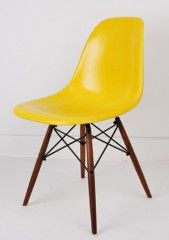 yellow eames chair for the tables