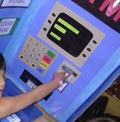 We had to have a bank to get all that money from! This is just a tri-fold science fair board that I covered with paper. I& still not sure the kids understood that money just doesn& magically appear out of ATM machines! Dramatic Play Themes, Dramatic Play Area, Dramatic Play Centers, Play Based Learning, Learning Through Play, Science Fair Board, Atm Bank, Kindergarten, Play Centre