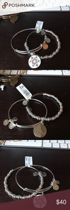 ❣️Rare ❣️last set of the shiny Alex and Ani silver ❣️Rare❣️ set of Alex & Ani shiny silver bracelets the first is a shiny beaded bracelet and the second is a shiny silver with a white and silver snowflake ❄️ beautiful set!! New with retail tags Alex & Ani Jewelry Bracelets