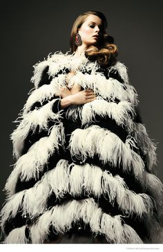 Gracing the pages of French Revue de Modes' fall-winter issue, model Anouk de Heer keeps warm in luxe looks including fur, fringe and feathers. Richard Bernardin captures the dark-haired beauty in the studio with styling by Annabelle Jouot.