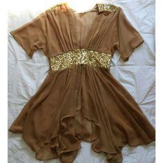 Dress Taupe/gold (So sex and the city ).                    Now you can visit my blog @ livinlavidamari.com. Dresses