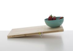 Balanced by Pierre-Francois Dubois - These two cutting boards playfully integrate a scale into the design of the traditional cutting board. The first allows the user to adjust the scale to determine weight, while the other board is used to counter-measure weights of two different objects. | Leibal