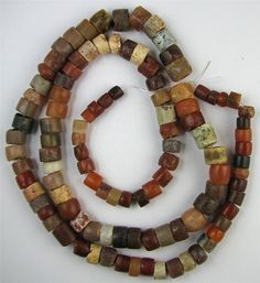 Nice Antique RARE Excavated Carnelian Stone Mali African Trade Beads 28 Inches | This is a great strand from my collection. A FANTASTIC LONG STRAND OF ANTIQUE RARE EXCAVATED CARNELIAN AGATE STONE MALI AFRICAN TRADE BEADS. MOST OF THE BEADS ON THE STRAND HAVE THE OLD PRIMITIVE HOLLOWED OUT BORED DRILL HOLES FROM SOME TYPE OF REVOLVING TOOL. These beads have the nice worn feel to them which you only get from the old beads like this strand. #tradebeads