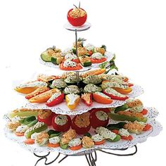 Very Tempting Veggies - A great way to add bright color and lighter fare to any celebration.  Choose your favorite veggies, cut them up and pipe them in with Herb Cheese Spread or choose another cheese spread recipe you love. Place on our Cupcakes 'N More Dessert Stand to serve.