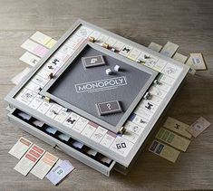 Specially designed for those who like to play in style, the Monopoly Luxury Edition makes a perfect holiday gift. It's crafted of wood in our Livingston Gray finish with a textured faux leather inset to match our favorite McKenna Jewelry Scrabble Board Game, Monopoly Board, Scrabble Wall, Monopoly Game, Pottery Barn, Home Music, Game Room Furniture, Pallet Furniture, Root Beer
