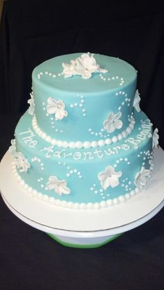 Blue fondant cake with flowers by the SUGAR FAIRIES