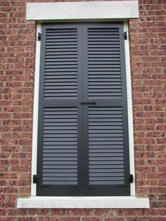 Louvered Shutter On False Window With Slide Bolt