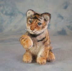 Cute little felted tiger cub