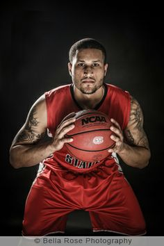 Dramatic sports portrait with dramatic studio lighting. Damarius Cruz St Cloud State University Huskies Mens Basketball photographed by Bella Rose Photography Saint Cloud MN