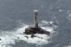 Zoom in and you can see a man abseiling on the tower! 2 km off the coast of Lands End in Cornwall and standing on Carn Bras - the highest of the Longships islets. The original Longships Lighthouse was build in 1795 and this one was built in 1869 by Trinity House - Cornwall aerial image - Longships Lighthouse aerial image by John Fielding #longships #lighthouse #coast #cornwall #trinityhouse #landsend #aerial