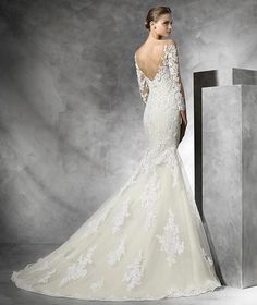 The v-back on this gorgeous lace fit n flare is visually stunning! Available at Spotlight Formal Wear! #SpotlightBridal