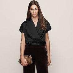 6006cef5b408b Iona Black Draped Wrap Top - REISS   The iona draped wrap top in black plays