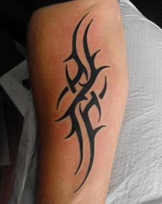 Google Image Result for http://tatopia.com/wp-content/uploads/2012/03/tribal-tattoos-12.jpg