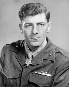 """Pfc. Hector Cafferata of Venice, Fla. is pictured with the Medal of Honor. He will tell you he was no hero; he was just saving his backside when he killed over 100 enemy soldiers in the battle for """"Fox Hill"""" during the early months of the Korean War.  Double click to read the entire story."""