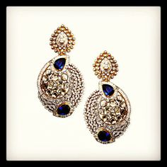 Exquisite diamond earrings with blue stones