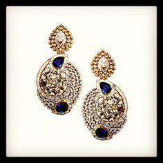 Exquisite diamond earrings with blue stones