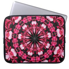 A laptop sleeve with pink Cyclamen flower pattern.