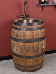 Whiskey Barrel Bar Sink with Copper Basin.  A very interesting gift idea for people who love their drinks...